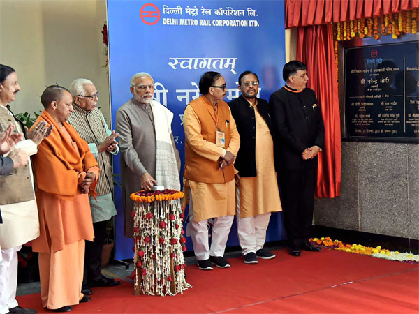 Prime Minister, Narendra Modi unveiling the plaque to mark the inauguration of Botanical Garden-Kalkaji Metro Line at Botanical Garden, in Noida, Uttar Pradesh on Monday . Also seen are Uttar Pradesh governor, Ram Naik, Uttar Pradesh CM Yogi Adityanath and h, the Minister of State for Culture (I/C) and Environment, Forest & Climate Change, Dr. Mahesh Sharma. PTI Photo