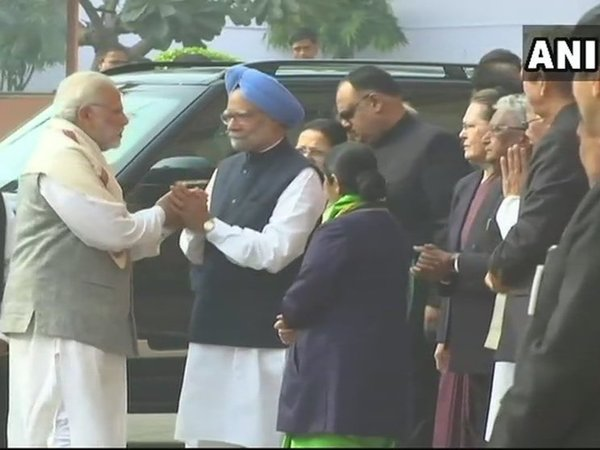 Prime Minister Narendra Modi meets former PM Manmohan Singh at the Parliament. Courtesy: ANI news