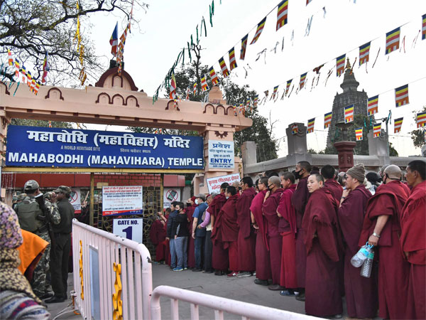Police personnel stand guard near the premises of Mahabodhi Temple in Bodh Gaya