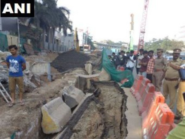 About 10 feet long stretch of Anna Salai road caved in on Friday. Courtesy: ANI news