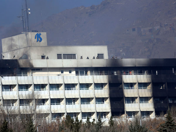 Afghan security personnel are seen at the roof of Intercontinental Hotel after an attack in Kabul, Afghanistan