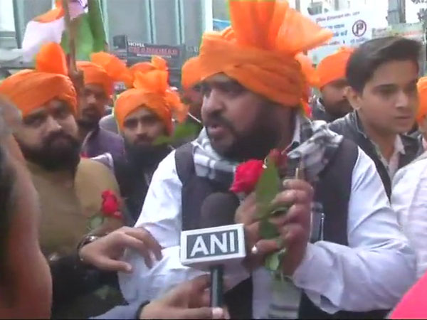 Protesters at Lucknow's Novelty cinema presented roses to people and appealed to them to not watch the film. Courtesy: ANI news