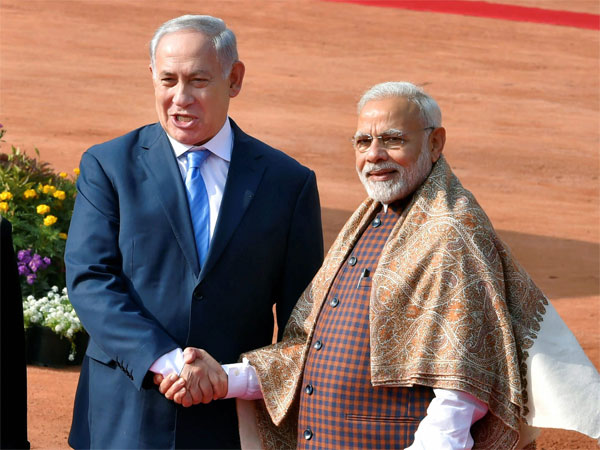 Prime Minister Narendra Modi welcomes his Israeli counterpart Benjamin Netanyahu during a ceremonial reception at the forecourt of Rashtrapati Bhawan in New Delhi