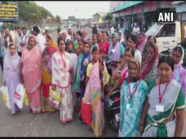 Women passengers in Tamil Nadu wait for buses to start their operation on Friday