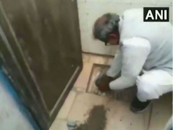 BJP MP Mishra cleans toilet with hands