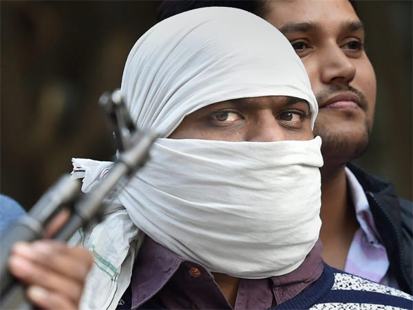 Ariz Khan alias Junaid, one of the most wanted Indian Mujahideen terrorist being taken to a court by Delhi Police Special Cell after his arrest, in New Delhi.