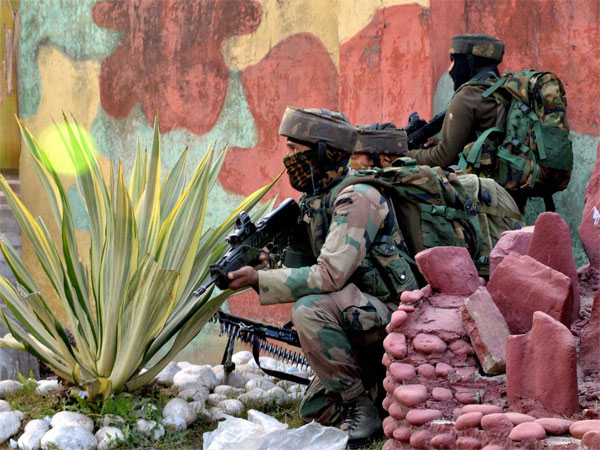 Security personnel takes positions during a militants attack Sunjuwan Army camp in Jammu on Saturday. PTI Photo