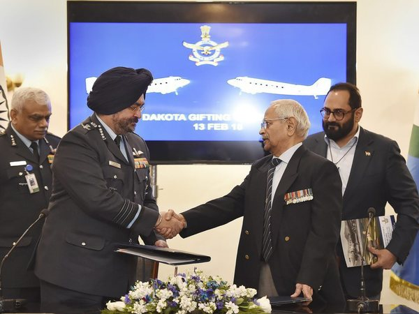 Air Chief Marshal B S Dhanoa shakes hands with Air Commodore (retd) M K Chandrasekhar, as Rajya Sabha MP Rajeev Chandrasekhar looks on during a function to mark ceremonial gifting of the Douglas DC3 Dakota to IAF, in New Delhi on Tuesday. PTI Photo