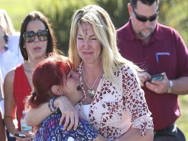 Parents wait for news after a reports of a shooting at Marjory Stoneman Douglas High School in Parkland, Fla., on Wednesday, Feb. 14, 2018. AP/PTI