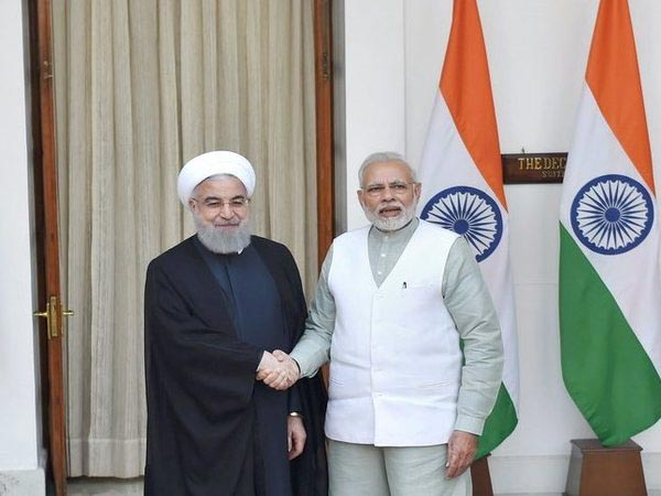 Prime Minister Narendra Modi shakes hands with Iranian President, Hassan Rouhani before their meeting at Hyderabad House in New Delhi on Saturday. PTI Photo