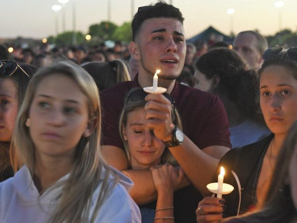 Mourners gather at a vigil that was held for the victims of the shooting at Marjory Stoneman Douglas High School, Thusday, Feb. 15, 2018, in Parkland, Fla. The teenager accused of using a semi-automatic rifle to kill more than a dozen people and injuring others at a Florida high school confessed to carrying out one of the nation's deadliest school shootings and concealing extra ammunition in his backpack, according to a sheriff's department report released Thursday. PTI photo