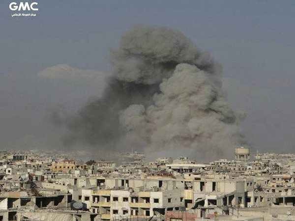This photo released on Friday, Feb. 23, 2018 by the Syrian anti-government activist group Ghouta Media Center, which has been authenticated based on its contents and other AP reporting, shows smoke rising after Syrian government airstrikes hit Ghouta, suburb of Damascus, Syria. PTI