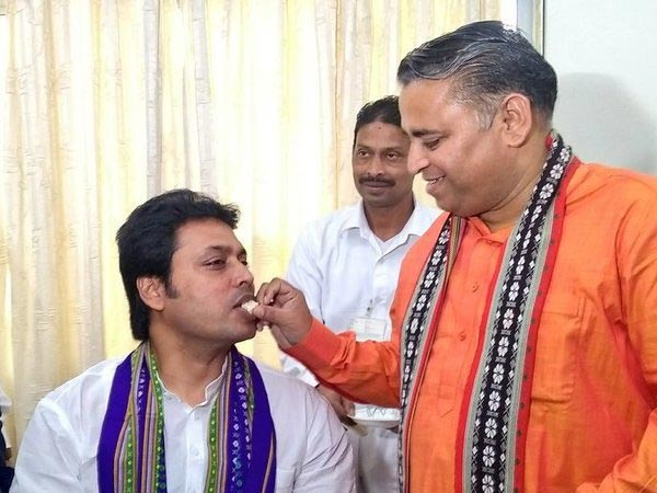 Biplab Kumar Deb took charge as Chief Minister, Sunil Deodhar offers sweets. Courtesy: @BjpBiplab
