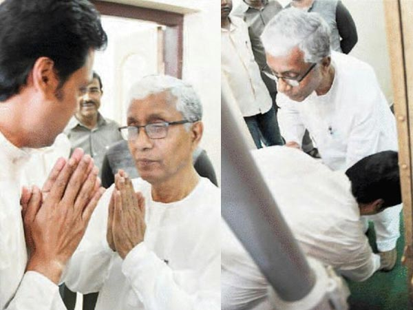 Touching: Biplab Deb touches Manik Sarkar's feet at swearing-in, says we need his experience