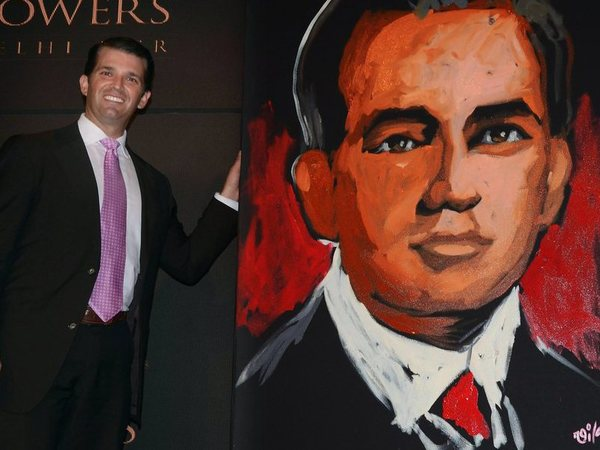 Donald Trump Jr. poses with his portrait. PTI file photo