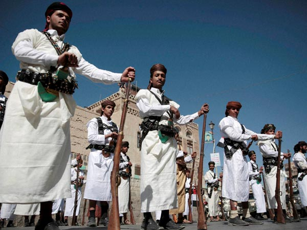 Shiite rebels, known as Houthis, wearing traditional costumes. PTI file photo