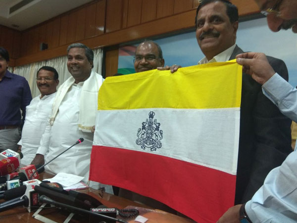 File photo of Kannada flag being unveiled by Siddaramaiah