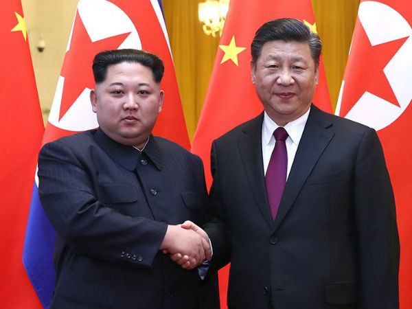 File photo of Kim Jong-un with Xi Jinping