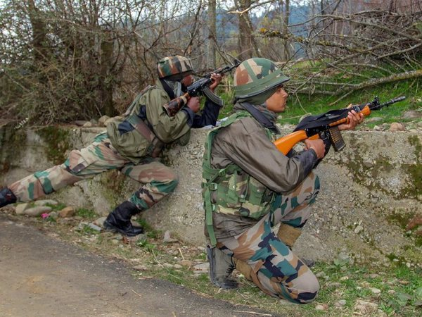 Army personnel stand guard as at least four militants and four security personnel were killed during an encounter, at Halmatpora in Kupwara district of North Kashmir on Wednesday. PTI Photo