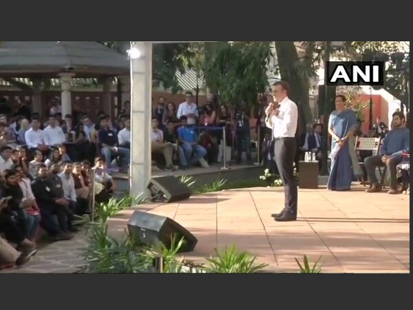 Emmanuel Macron interacts with students in Delhi