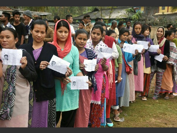 Women stand in a queue to cast their vote at a polling station during assembly election. PTI file photo