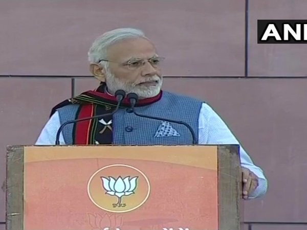 PM Modi addressing party workers at BJP headquarter. Courtesy: ANI news