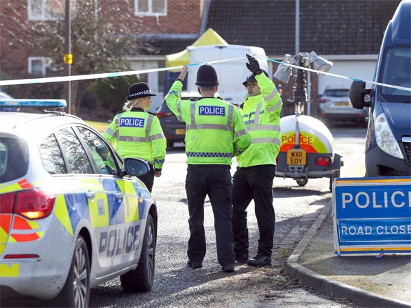 Police officers seal off a cul-de-sac in Salisbury, England, near to the home of former Russian ex-spy Sergei Skripal as a nerve agent is believed to have been used to critically injure him and his daughter Yulia. Britains Home Secretary says the investigation into the nerve agent attack on a Russian ex-spy and his daughter is focusing on three sites — his home, a pub and a restaurant.