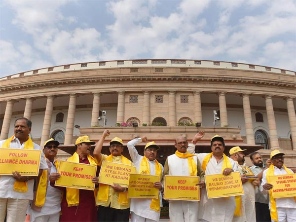 TDP party leaders hold placards and raise slogans demanding special status for the state of Andhra Pradesh during the budget session, at Parliament House in New Delhi on Wednesday. PTI Photo