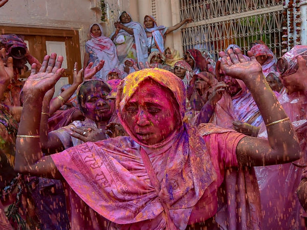 Widows in India get drenched in colours of Holi
