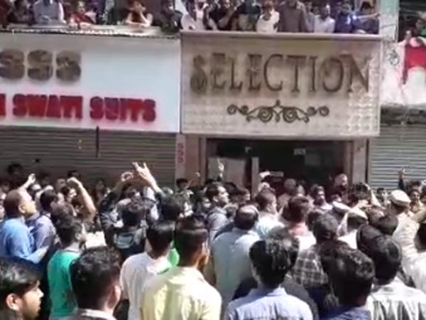 File photo of protests in Delhi over sealing of shops