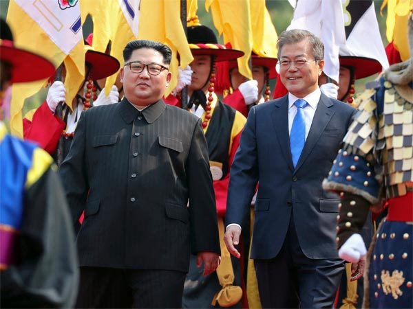 North Korean leader Kim Jong Un, left, and South Korean President Moon Jae-in inspect an honor guard ahead of their historic face-to-face talks, in Panmunjom