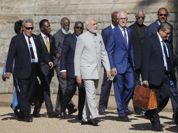 Australian Prime Minister Malcolm Turnbull, centre right, talks to the Indian Prime Minister Narendra Modi, centre left, as they arrive for the the second day of the Commonwealth Heads of Government 2018 for a behind closed doors meeting in Windsor, England