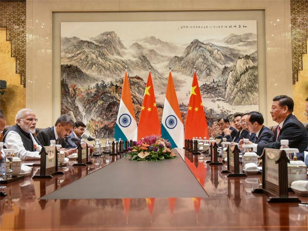 Prime Minister Narendra Modi during a meeting with Chinese President Xi Jinping and other officials during his visit in Wuhan, China