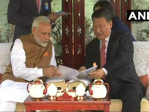 Prime Minister Narendra Modi & Chinese President Xi Jinping inside a house boat in Wuhans East Lake. Courtesy: ANI news