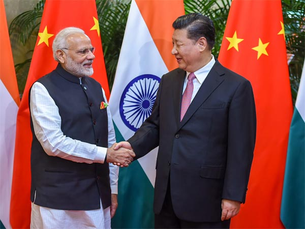 Prime Minister Narendra Modi shakes hands with Chinese President Xi Jinping during his visit in Wuhan, China. PTI file photo