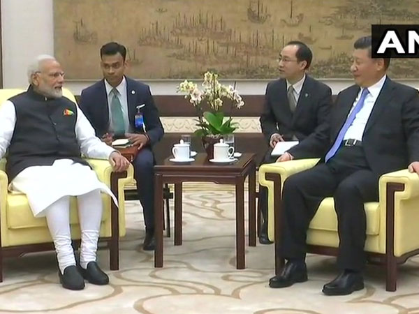 Modi holds informal talks with Xi Jinping
