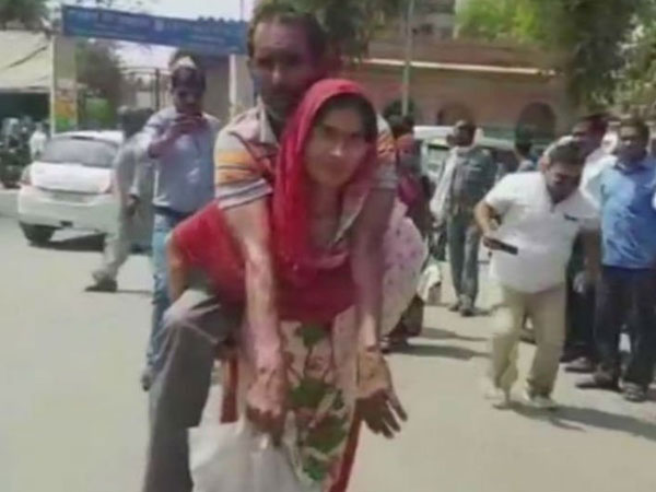 Sad but true: Woman carries husband on her back to get disability certificate