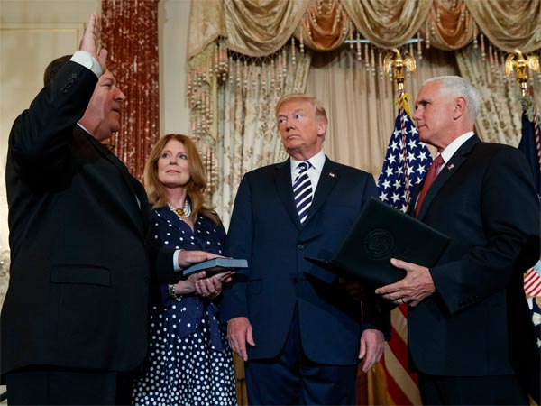 President Donald Trump looks on as Vice President Mike Pence administers a ceremonial swearing in to Secretary of State Mike Pompeo at the State Department