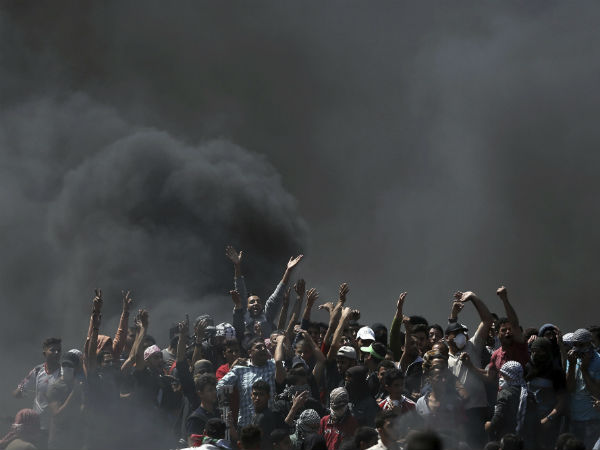 Tens of thousands protest on Gaza border, 37 dead in clashes
