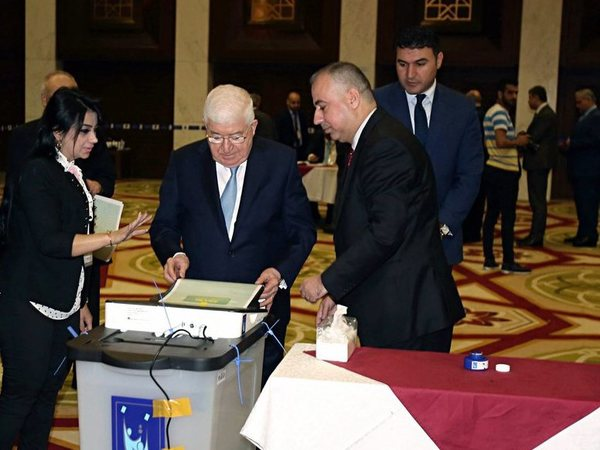 Iraqi President Fuad Masum, center, casts his vote in the countrys parliamentary elections in the heavily fortified Green Zone in Baghdad, Iraq, Saturday, May 12, 2018. Polls opened across Iraq on Saturday in the first national election since the declaration of victory over the Islamic State group. AP/PTI