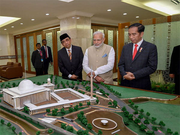 Indian Prime Minister Narendra Modi with Indonesian President Joko Widodo during a visit to Istiqlal Mosque, in Jakarta, Indonesia