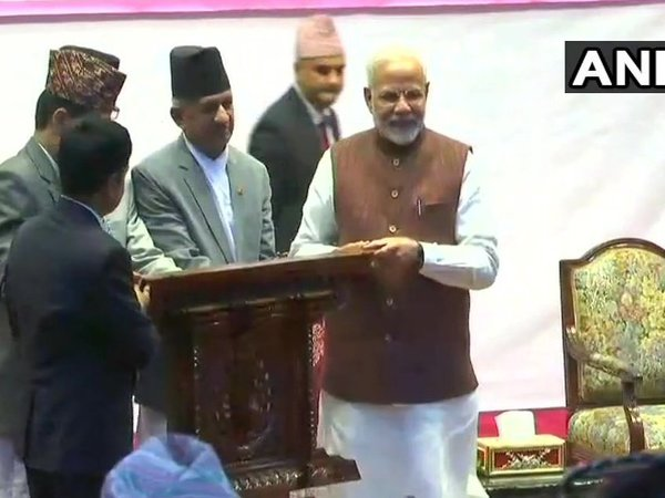 PM Narendra Modi was presented souvenirs at a civic felicitation program in Rastriya Sabha Griha in Kathmandu. Courtesy: ANI news