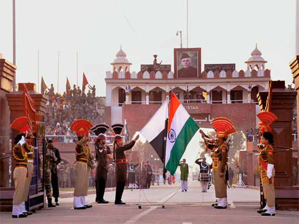 BSF and PAK Rangers lower the countries flags at the Beating Retreat border ceremony at Attari- Wagah Border. PTI file photo