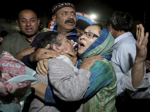 Relatives and friends of Shujaat Bukhari crying inside a police control room in Srinagar