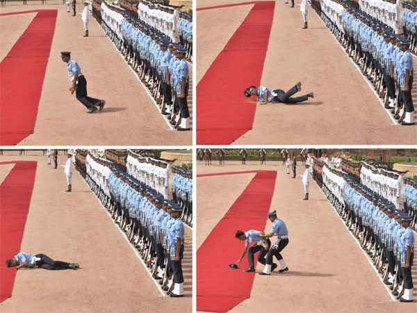 A member of the Indian Air Force, on Guard of Honour duty, faints during the ceremonial reception of Seychelles President Danny Antoine Rollen Faure at Rashtrapati Bhawan, in New Delhi