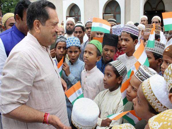 File photo of Indresh Kumar, National Executive member of RSS meeting Muslim children during the 70th Independence Day celebrations at a Madarsa in Nagpur (Image courtesy - PTI images)
