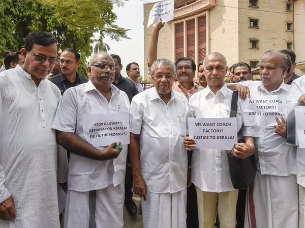 Kerala Chief Minister Pinarayi Vijayan along with his party MPs during their protest asking the Centre to withdraw its decision to abandon the much-awaited railway coach factory project planned at Kanjikode in Palakkad, in New Delhi on Friday, June 22, 2018. PTI file photo