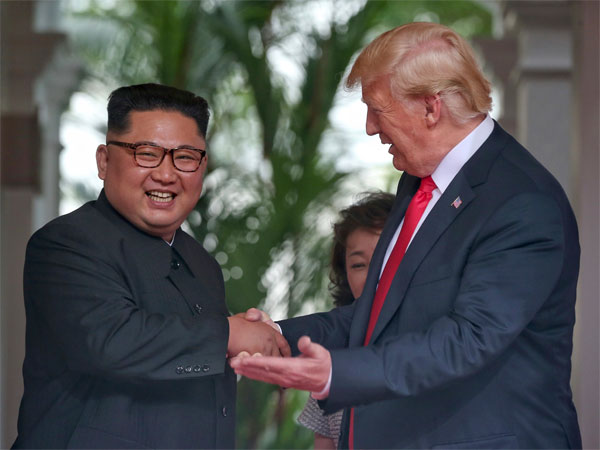 U. S. President Donald Trump shakes hands with North Korea leader Kim Jong Un at the Capella resort on Sentosa Island