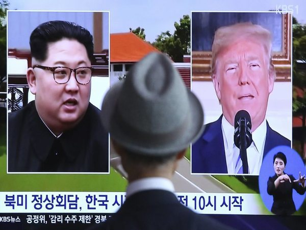 A man watches a TV screen showing file footage of U.S. President Donald Trump, right, and North Korean leader Kim Jong Un during a news program at the Seoul Railway Station in Seoul, South Korea. PTI photo
