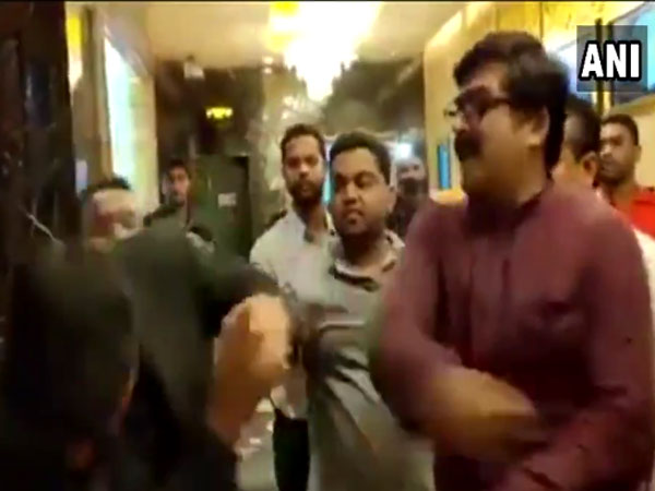 MNS workers slapping movie hall manager (Image courtesy - ANI/Twitter)
